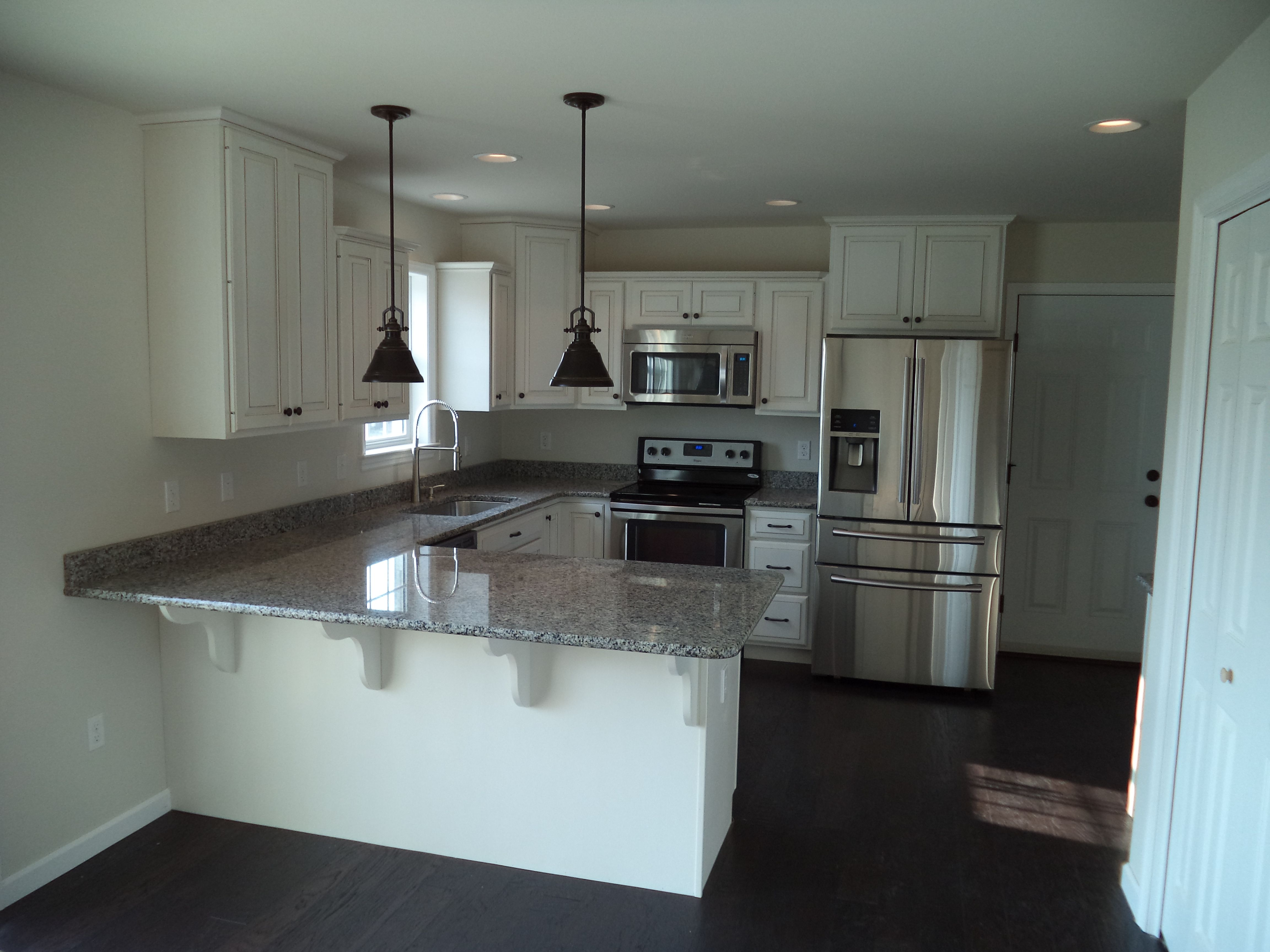 The kitchen of a Yorktown I-Maple cabinets with Glacier White finish ...