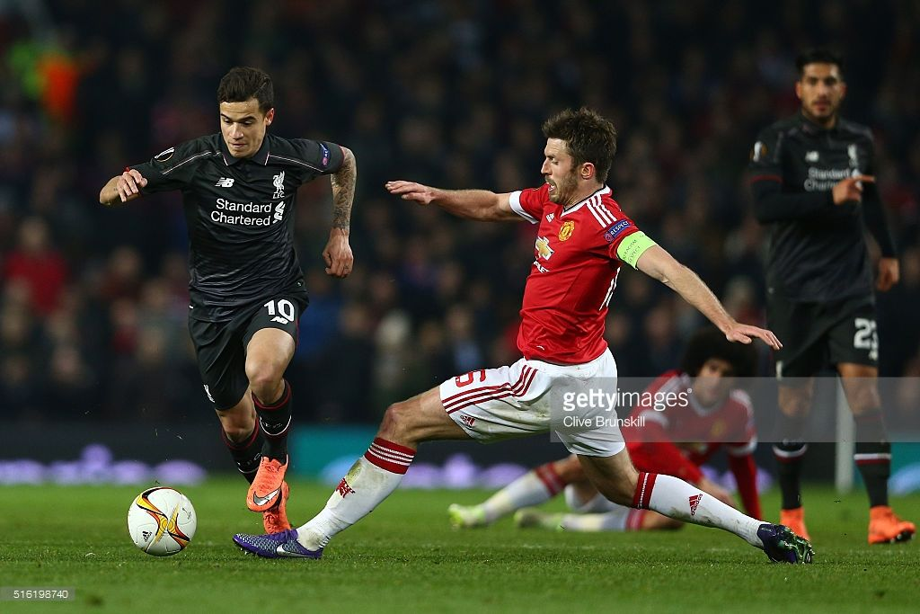 <a gi-track='captionPersonalityLinkClicked' href=/galleries/search?phrase=Philippe+Coutinho&family=editorial&specificpeople=6735575 ng-click='$event.stopPropagation()'>Philippe Coutinho</a> of Liverpool evades <a gi-track='captionPersonalityLinkClicked' href=/galleries/search?phrase=Michael+Carrick&family=editorial&specificpeople=214599 ng-click='$event.stopPropagation()'>Michael Carrick</a> of Manchester United during the UEFA Europa League round of 16, second leg match between Manchester U...