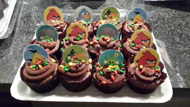 """Angry Birds Cupcakes complete with """"soil"""" being chocolate icing and chocolate coated sunflower seeds as the topping. Truly Bird food and yummy at the same time!"""