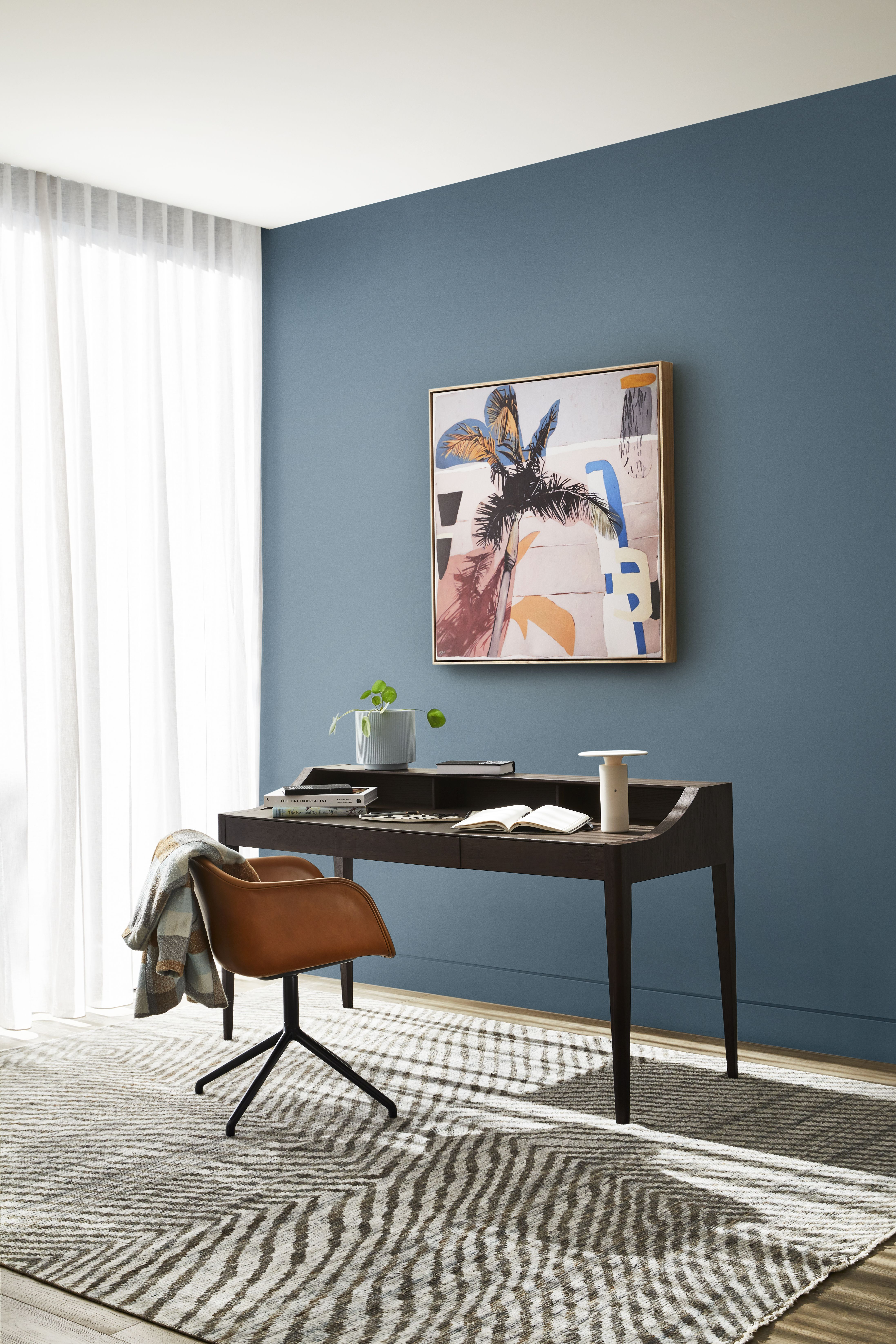 Desk With Blue Wall Behind It And Bright Artwork In 2020 Trending Decor Dulux Colour Decor
