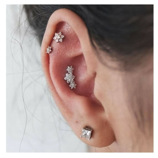 i am completely obsessed with this in ear piercing using a beautiful diamond flower garland. Black Bedroom Furniture Sets. Home Design Ideas
