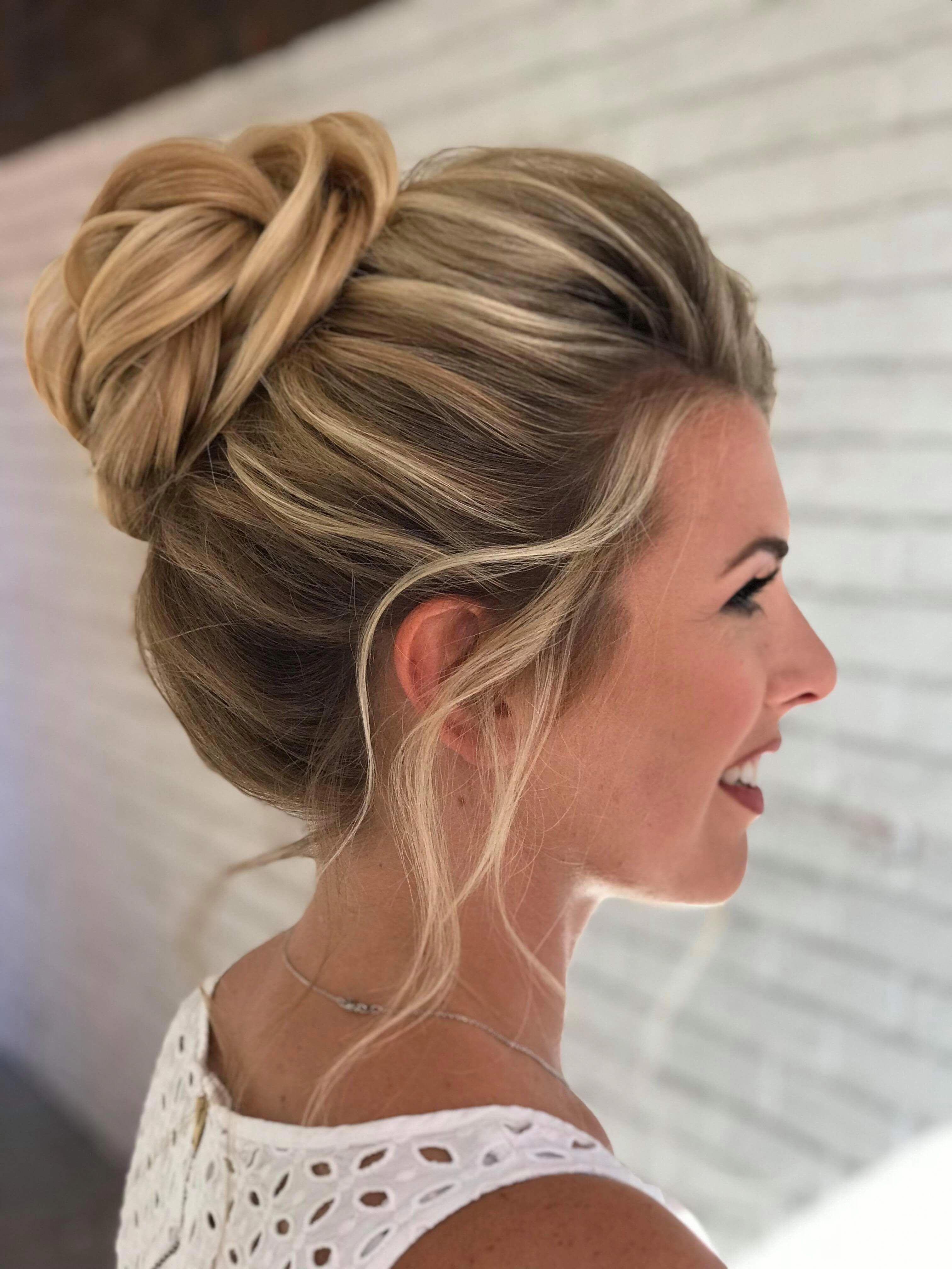 wedding hairstyle high bun on highlighted blonde hair