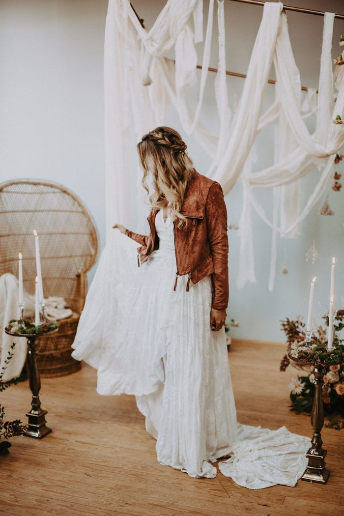 A camel-toned leather jacket is the perfect finishing touch for this rustic bridal look | Image by Local Embers & Co. #bridaljewelry #bridalnecklace #bohowedding #bohemianwedding #weddinginspiration #weddinginspo #weddingphotography #bride #bridalfashion #bridalstyle #bridalinspiration