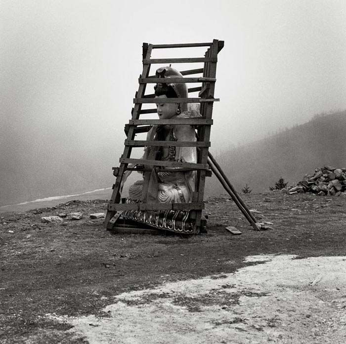 """LIU ZHENG, From the series """"The Chinese, Buddha in Cage"""", Wutai Mountain, Shanxi Province, 1998. Deutsche Bank Collection."""