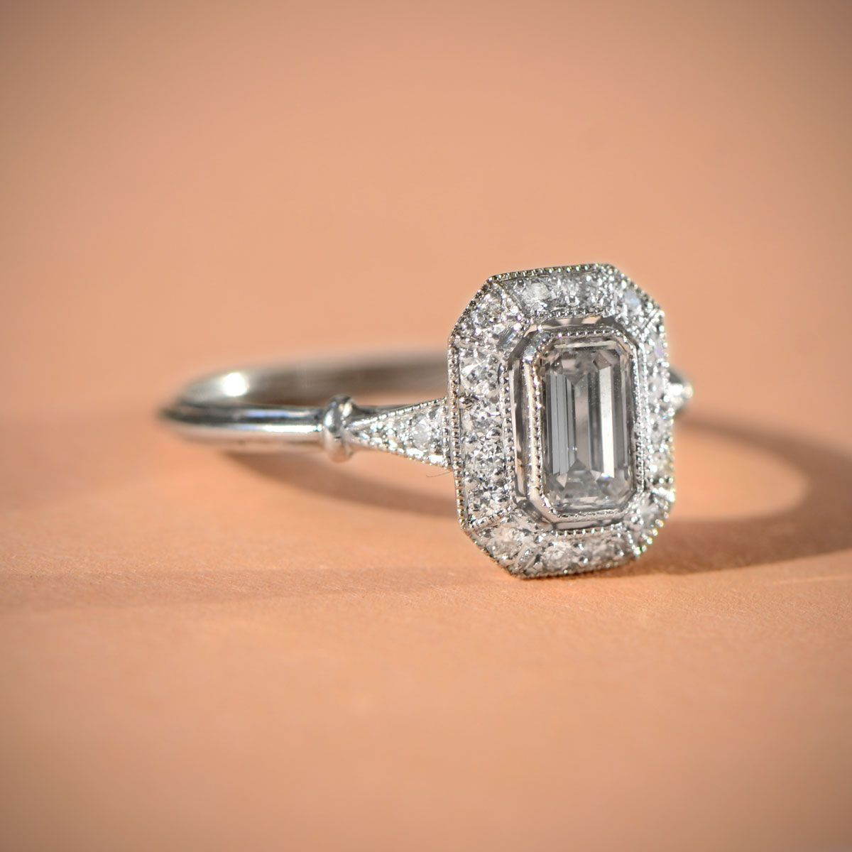 Oxford Ring Emerald cut diamond Halo engagement and Emerald cut