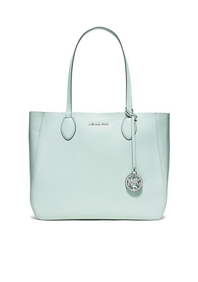 51d18fd9df63 Get two amazing bags in one with this large reversible tote! Carry a mint  handbag or reverse to silver. The signature Michael Kors logo charm dangles  from ...