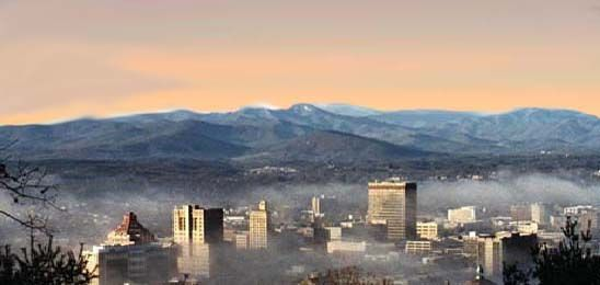 Winter View Of Asheville Nc Downtown And The Surrounding Blue Ridge Mountain Ridges With Snow Mountain City North Carolina Mountains Places To See