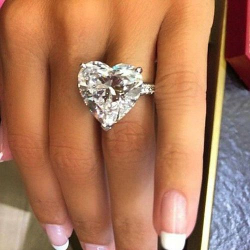 Beautiful Heart Shaped RingMaybe 100 CaratsMatching Earrings