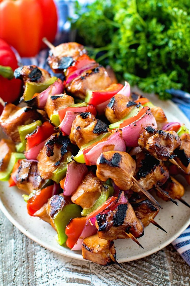 Photo of Tender, juicy chicken on skewers with peppers and onions ma …