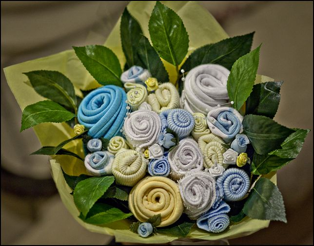 Paws re thread a crafty baby shower baby bouquets baby ideas baby shower gift bouquet thing made from bibs onesies i think she calls them singlets though and rolled socks makes different sized flowers negle Image collections
