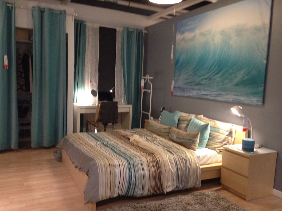 Beach themed bedroom with enormous ocean painting
