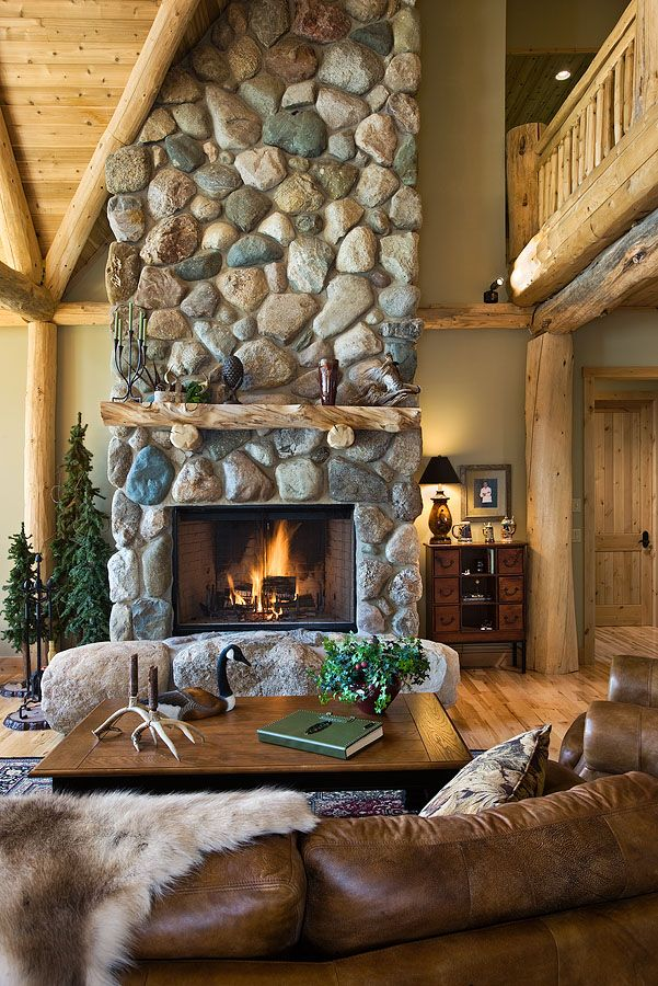 River rock fireplace log mantle log cabin ideas for Cabin fireplace pictures