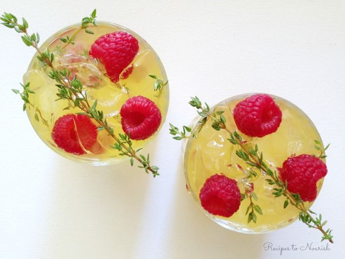 Raspberry Thyme Probiotic Seltzer ... refreshing + so easy to make! Layer some ice, raspberries, thyme + top with your favorite bubbly probiotic soda.   Recipes to Nourish