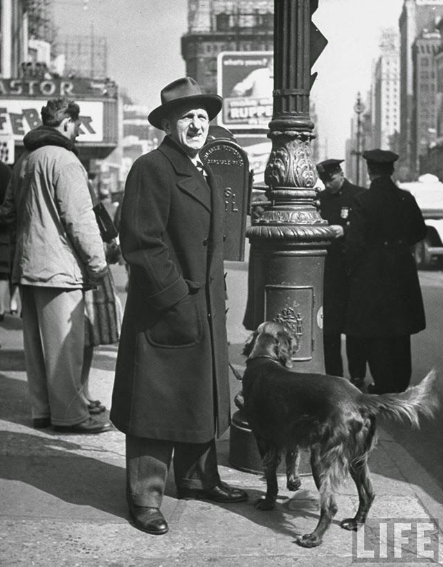 Famous People with Their Dogs on the Street of NYC in 1944 Comedian Jimmy Durante w. his Irish setter, standing on street corner in Times Square.. All photos are taken by LIFE photographer Nina Leen in 1944.