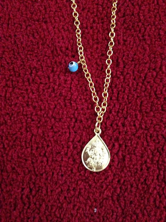 Om and Ganesha Pendant Necklace by tiltedarrow on Etsy, $30.00