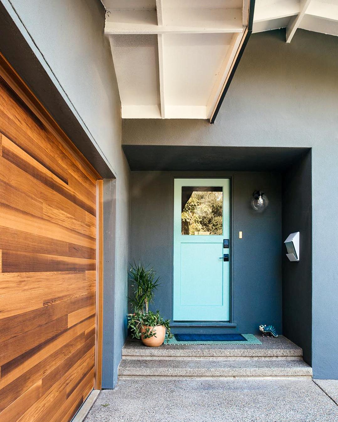 Cedar Planks Garage Door On Midcentury Modern Exterior In 2020 Garage Doors Wooden Front Door Design Modern Exterior