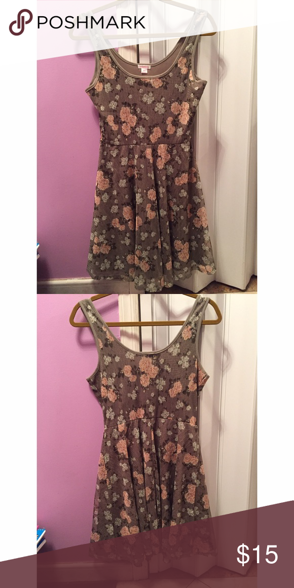 Floral Lace Tank Dress This is a nice dress, doesn't fit me so decided to sell it. Material is made out of 93% Polyester, and 7% Spandex. Xhilaration Dresses Mini