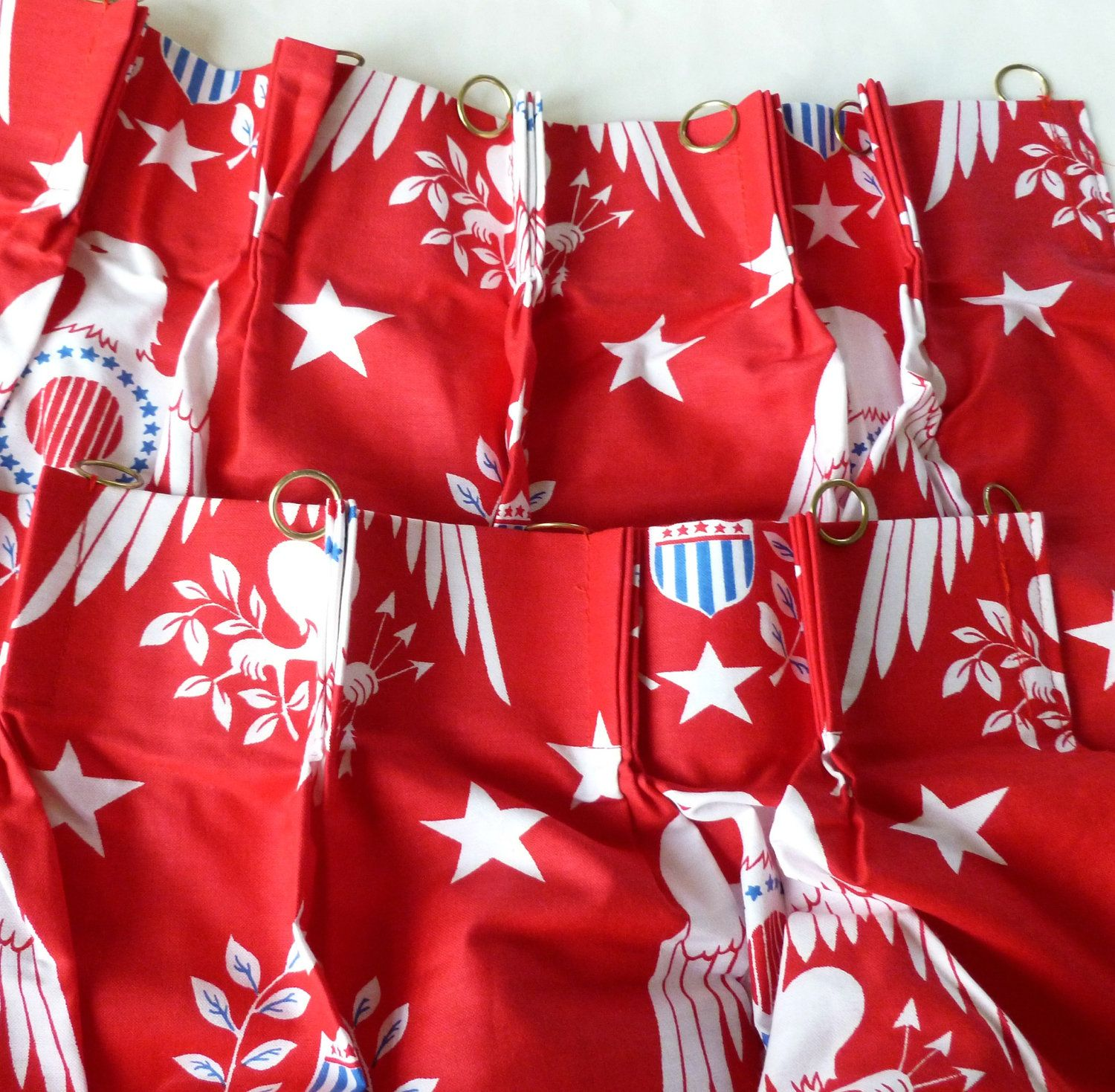 Patriotic Eagles and Stars Cafe Curtain Panels in Red, White and Blue Americana Pinch Pleat with Rings New Old Stock Unused Mid Century. $35.00, via Etsy.