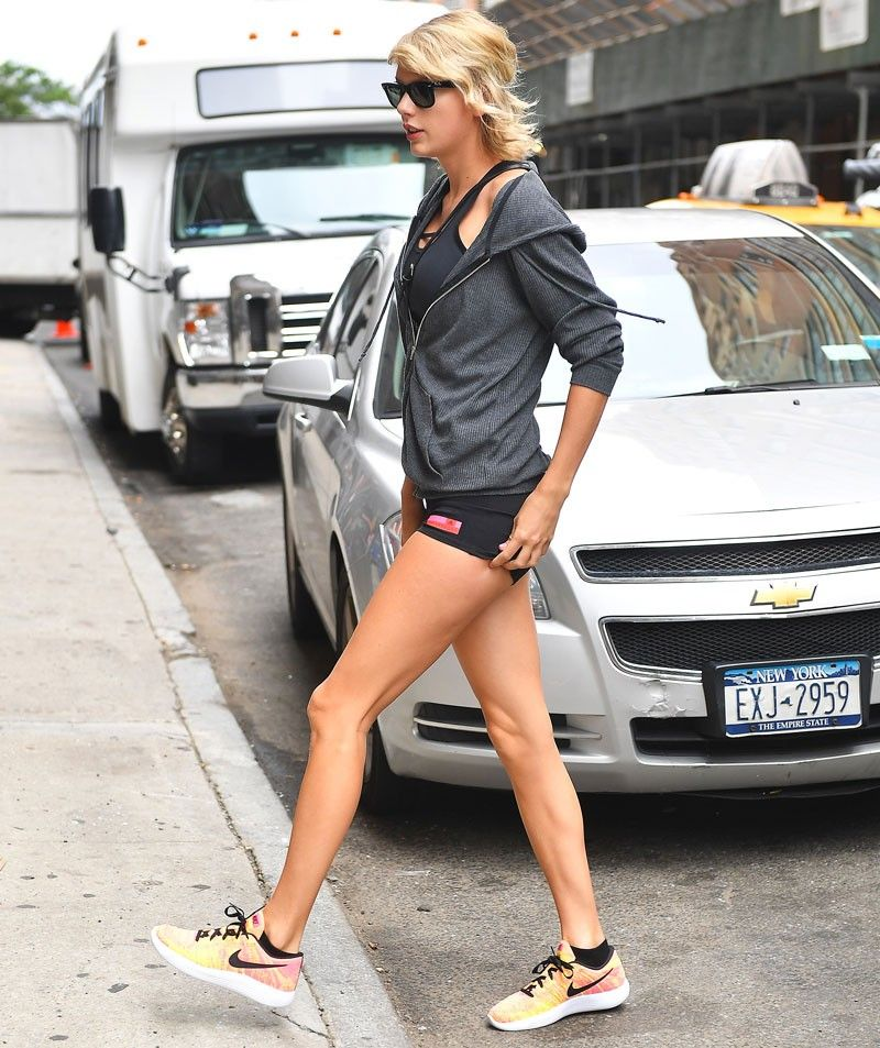 c9af6e3eccab Taylor Swift s Colorful Nike Sneakers Will Make You Want to Work Out via   WhoWhatWear