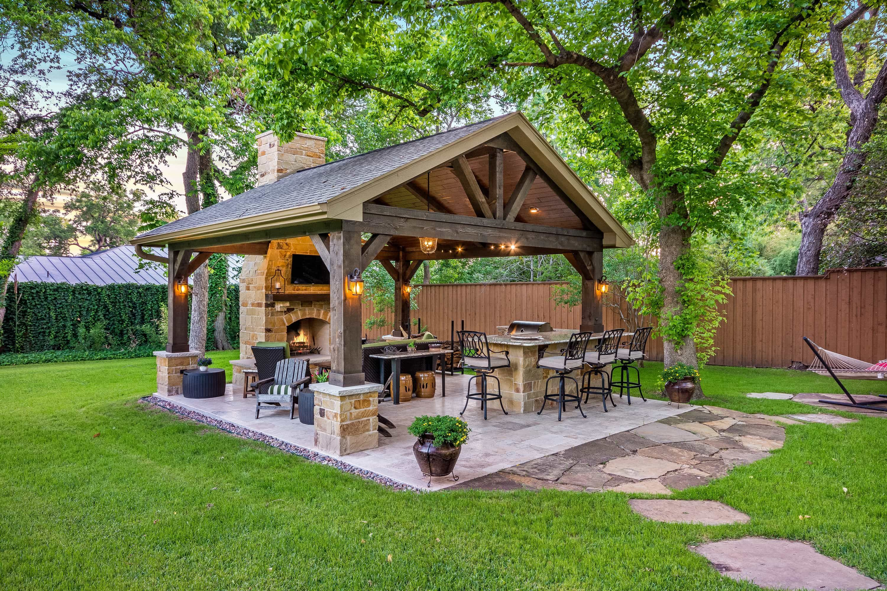 This Freestanding Covered Patio With An Outdoor Kitchen And Fireplace