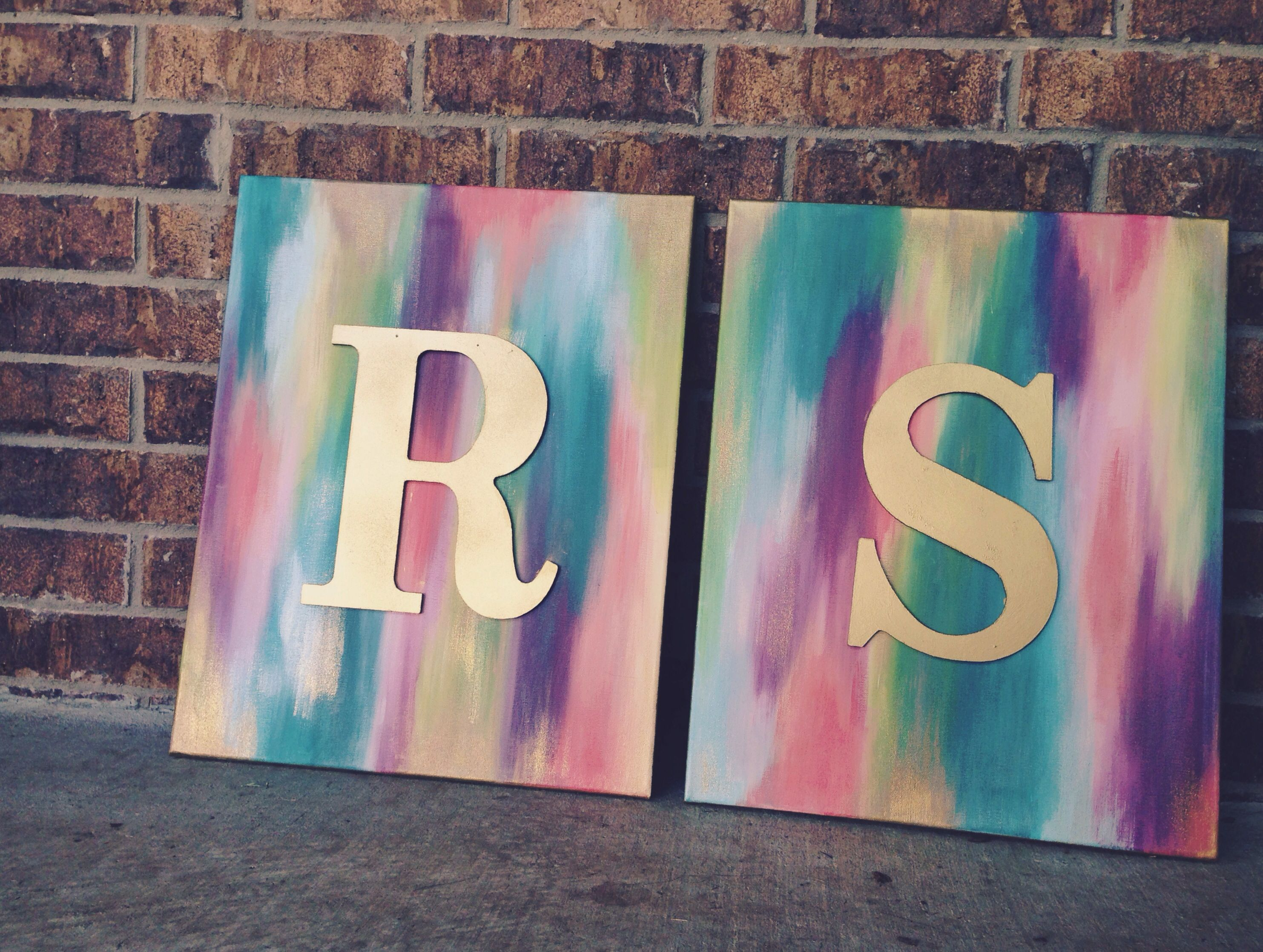 Gold Spray Painted Wooden Letters On Abstract Canvases