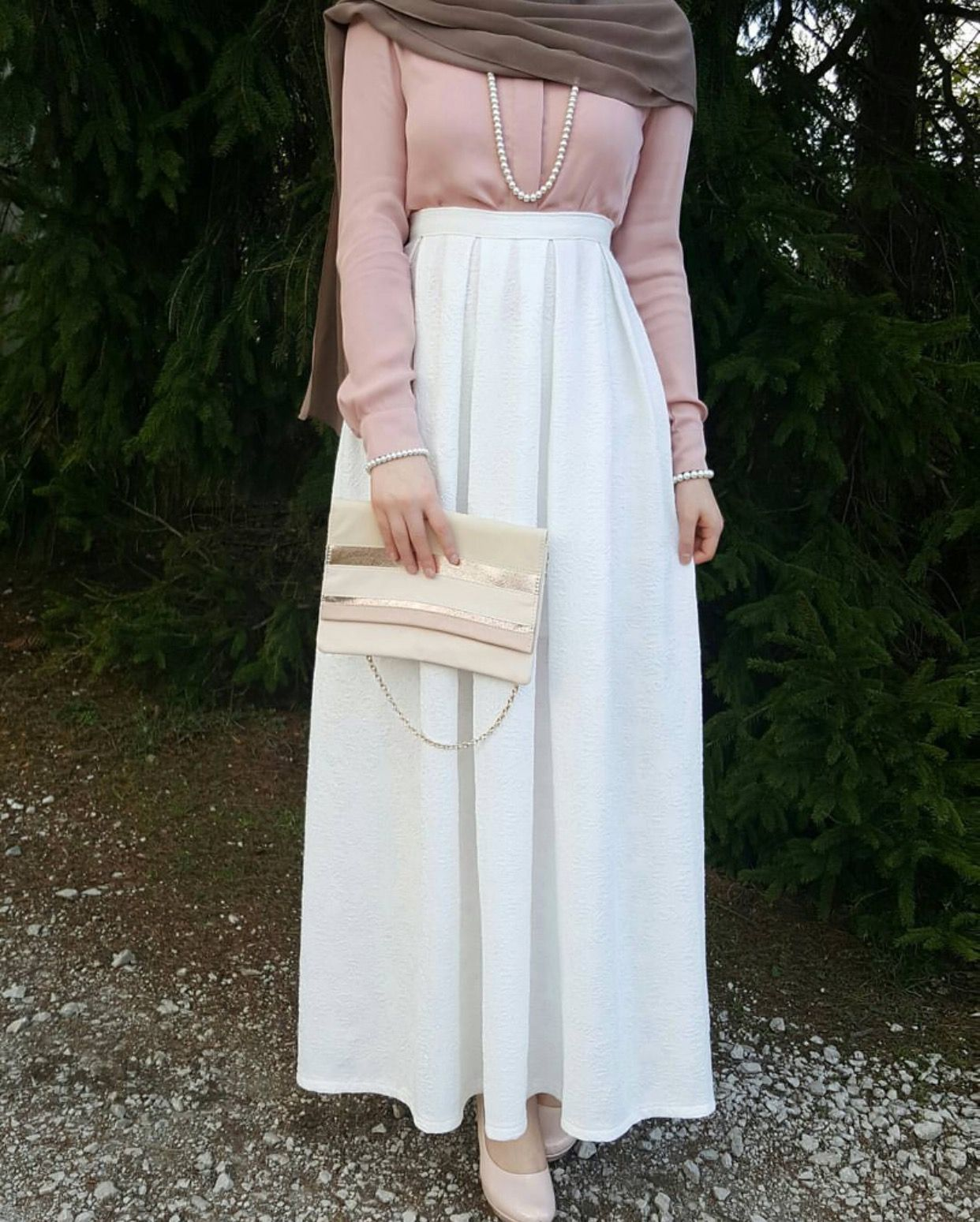 White skirt and blush blouse maybe other accessory check out