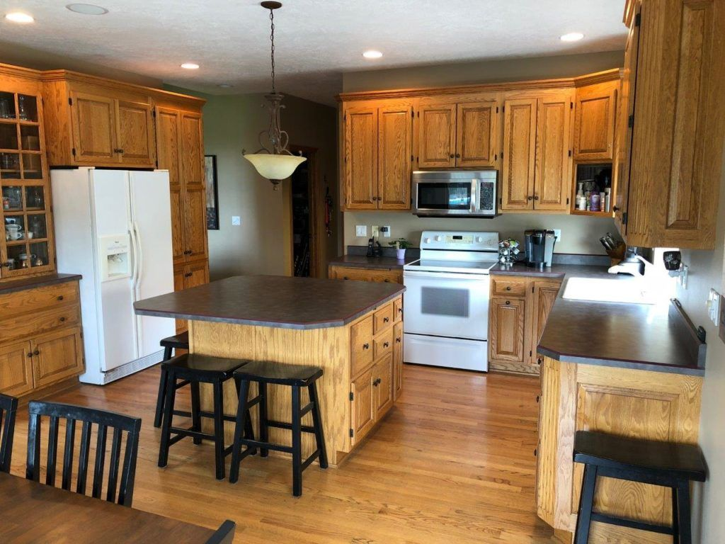 Should I Paint My Oak Cabinets Or Keep Them Stained A Questionnaire Stained Kitchen Cabinets Oak Kitchen Cabinets Staining Cabinets