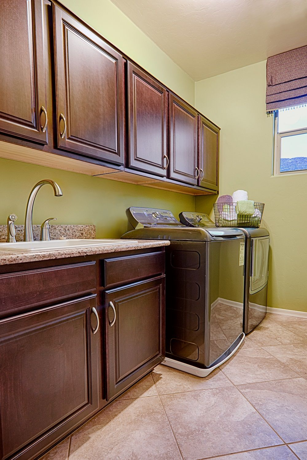 Laundry Room With Cabinets Sink Tile Floor And Window Brittney