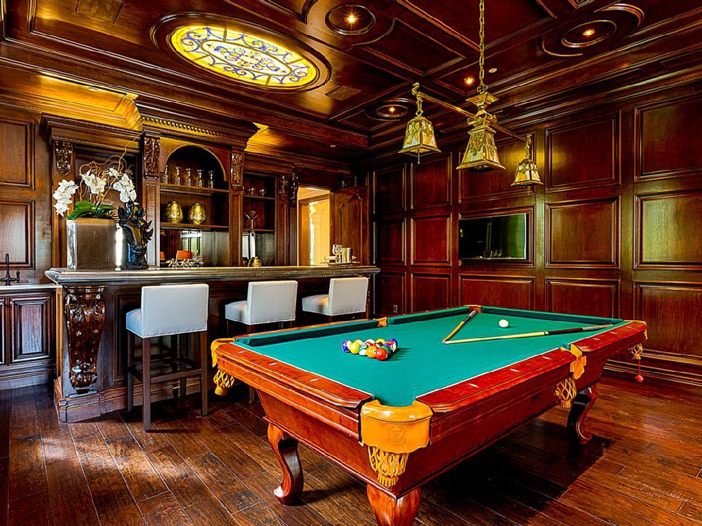 Recreation room with bar and pool table in luxury home in