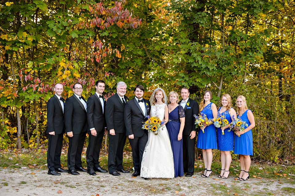 Dark Blue And Yellow Wedding: And Groomsman In Black Tuxes With Bridesmaids In Royal