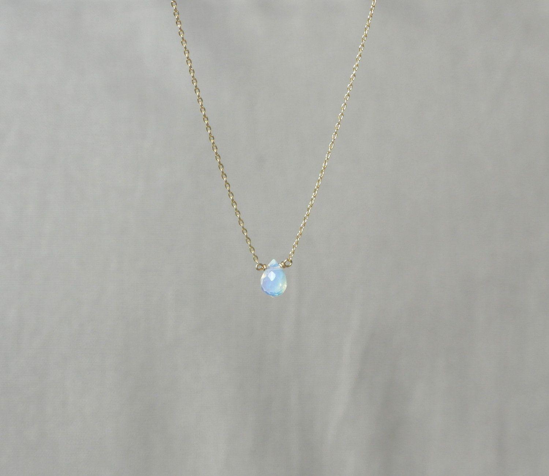 delicate simple everyday teardrop opal gemstone gold