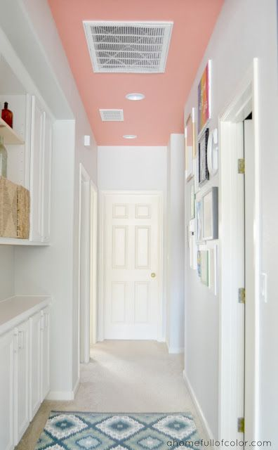 Consider only painting the ceiling! Behr Youthful Coral ceiling with Behr  Dolphin Fin walls - I like this unexpected