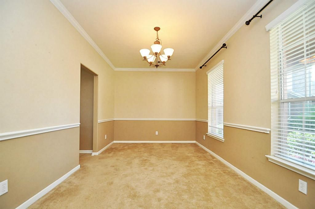 Bedroom Paint Ideas Two Colors view of formal dining room from the doorway. nice chair rail with