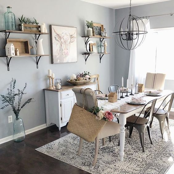 Farmhouse Grey and White dining room with beautiful spheric candle - style chandelier