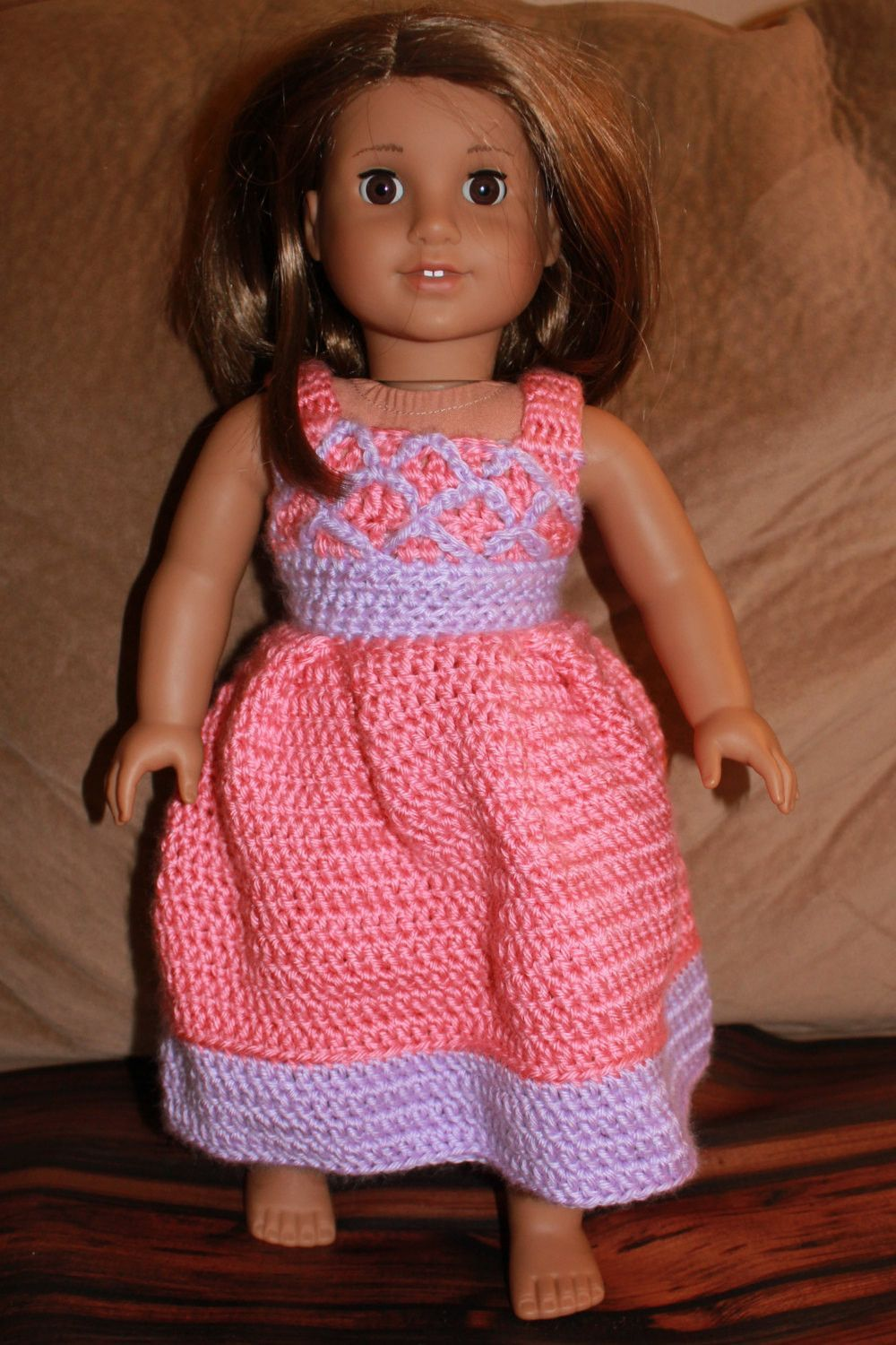 The beautiful crocheted doll dress has a stunning design. This would be adorable to dress up any 18 inch doll. It can be made in a variety of colors. If you have any questions, or would like a custom