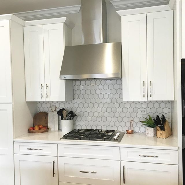 Here's another view of the finished backsplash. If I hadn't have been filming a video for my business at the time of grouting, I think I would have done white. But oh well! #whitekitchen #newbacksplash #modiqueinteriors #marblebacksplash