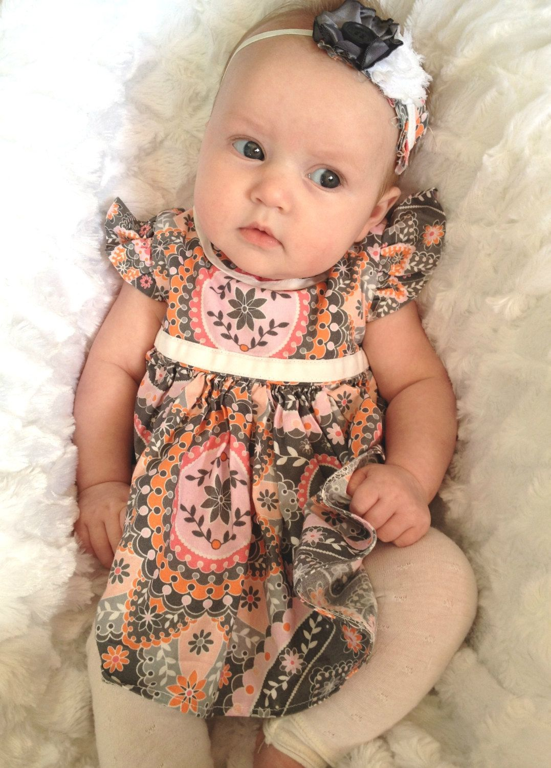 Newborn Baby Girls Gray Pink and White Ruffle Dress with Lace Jersey Ruffled Leggings and Headband. $34.99, via Etsy.