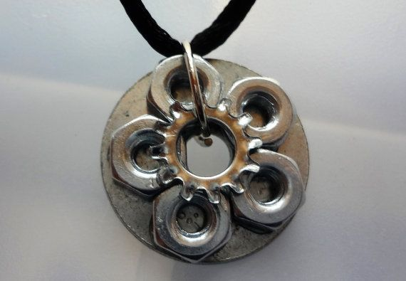 I covered the flat washer with hexagon nuts and shakeproof washer. It goes really well with some of the hardware earrings in this store. The