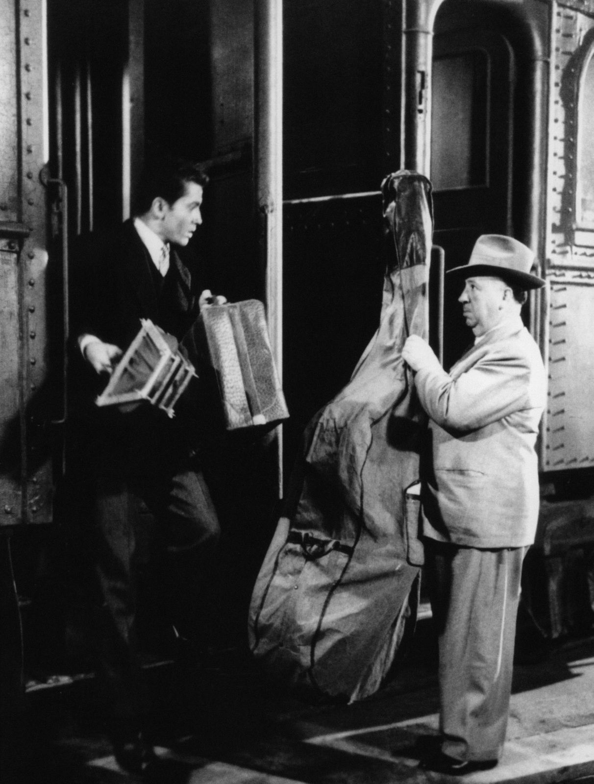Strangers on a Train (1951), Alfred Hitchcock cameo