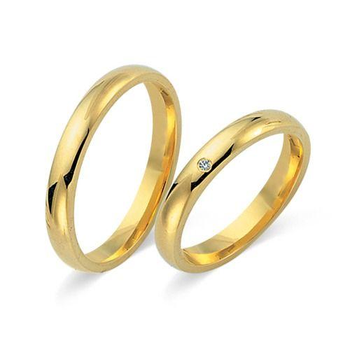 Besondere eheringe gold  Hochwertige Eheringe aus 585er Gelbgold mit Diamant ...