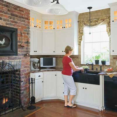I've always loved the idea of a fireplace in the kitchen. Would love to be able to cook on an open flame inside.