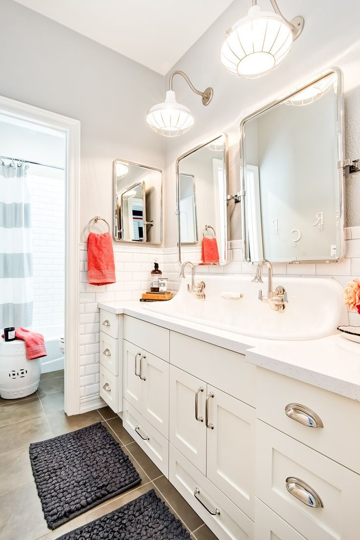 Kid\'s bathroom complete with ample lighting and crisp clean design ...