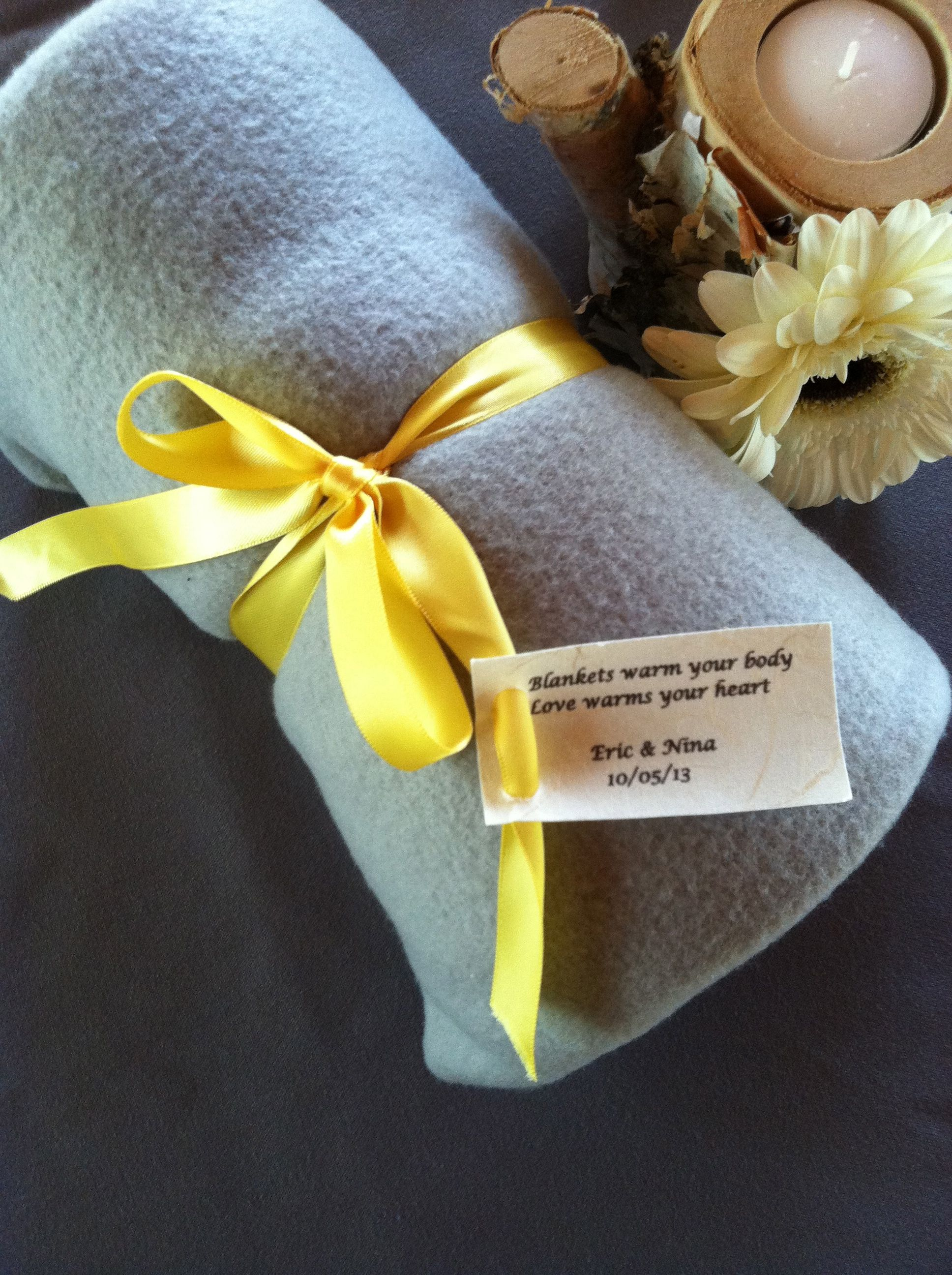 Nina & Eric provided blankets as guest favors at their October wedding at Meadow Ridge Events. What a great idea for fall outdoor weddings!