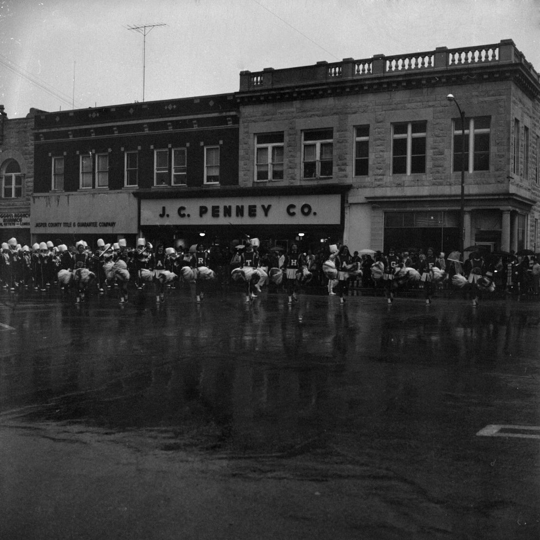 Cheerleaders And A Marching Band From Carthage Mo Marching In The