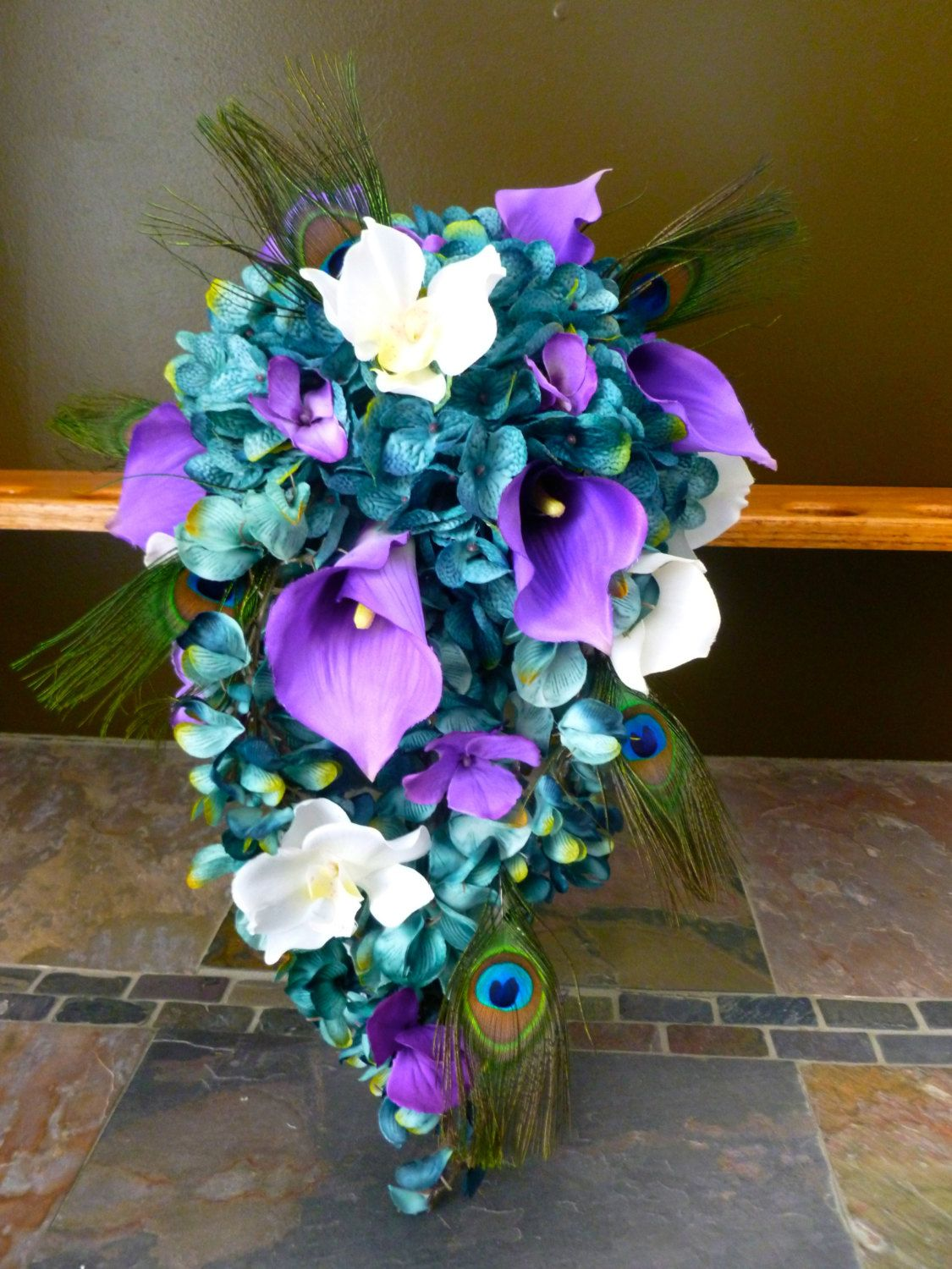 Cascading bridal bouquet with teal hydrangeas by