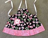 Adorable little girls apron - black with sweet pea floral - adjustable straps