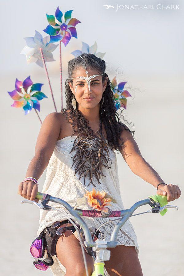 Burning man 2013 cargo cult black rock city playa jonathan clark woman on bicycle usa people ...