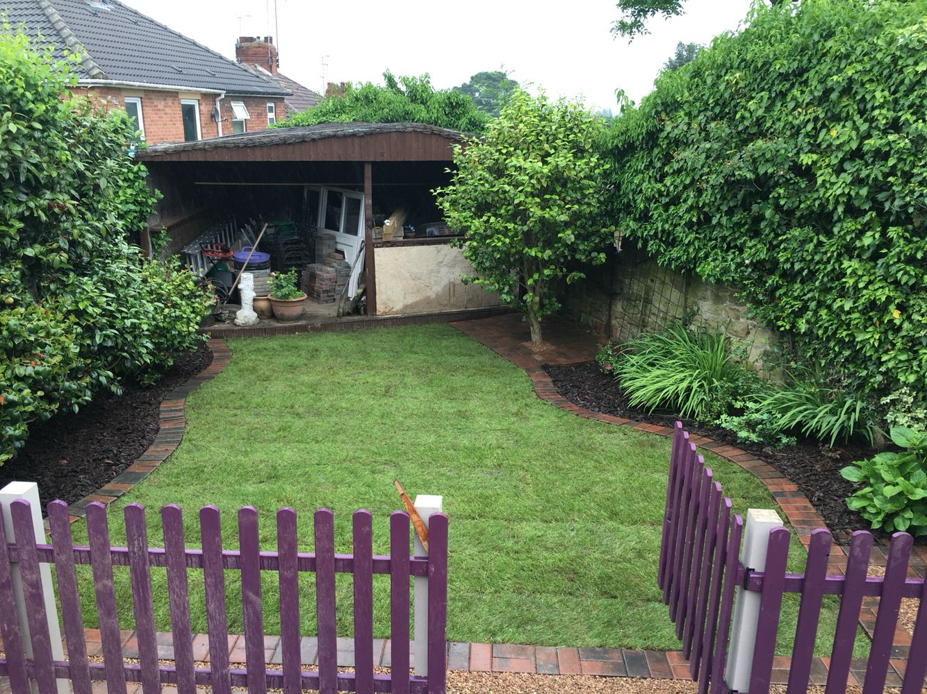Freshly laid turf, Block paved edging with drainage and barked boarders