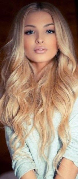 Center-parted Blonde Curls. I love the curls and the length!!