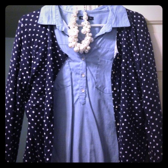 "Banana Republic Size M Polka Dot Cardi Navy blue with white ""smudged"" polka dots, this is one of my favorite cardis to layer with! It's long sleeved with all buttons intact. Says petite but will fit a true medium! My go to look with this cardi is a chambray shirt underneath. So many things you can do with it! Banana Republic Sweaters Cardigans"
